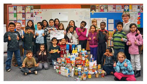 the students in sherri brothers second grade class at college place elementary celebrated the 100th day of school by reaching their goal of 100 cans for