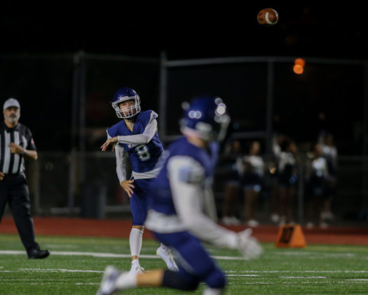 Mavs' quarterback Hunter Moen throws the ball to Justin Jackson