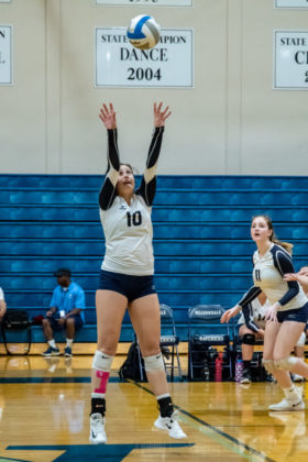Adah Hall launches a set to the outside hitter.
