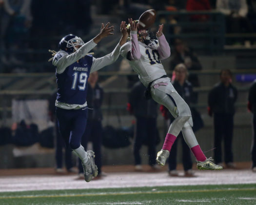Everett's Cody Bennett jumps up to intercept a ball that was intended for Ray Free