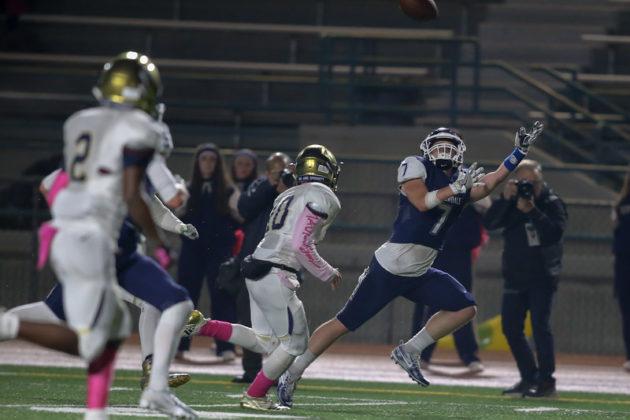 Nate Hebert reaching for a pass