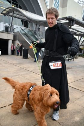 Many ran in costumes like this Jedi Knight with his Wookie.
