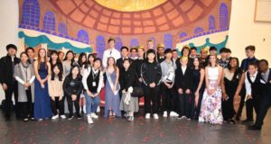 Sister city students with homecoming court.