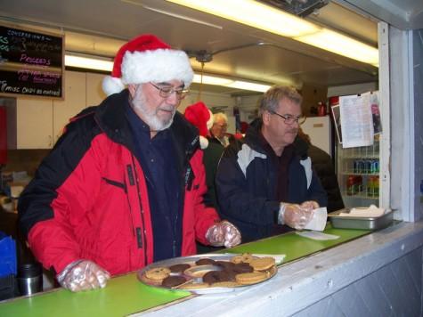 Volunteers serving cookies at the 2008 tree lighting ceremony