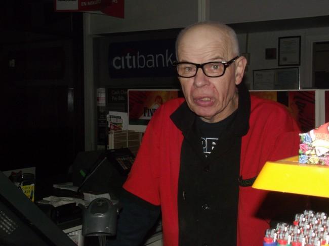 7-11 clerk Burton Wangerin greets customers arriving during his graveyard shift.
