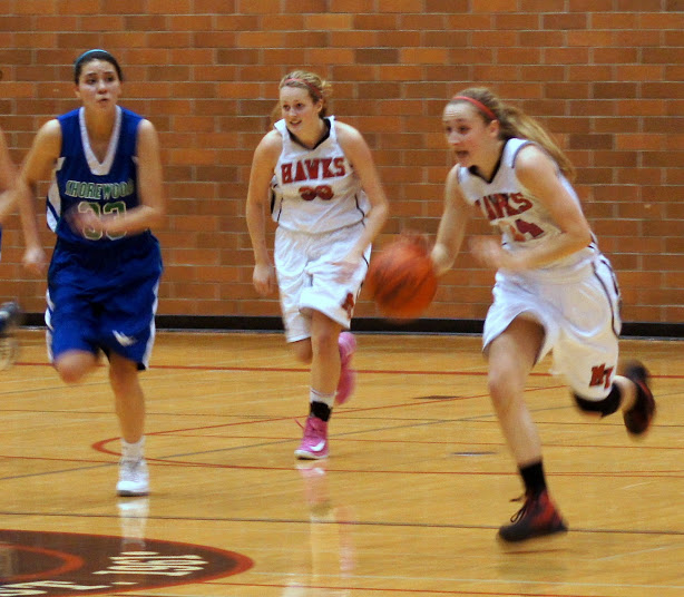 Samantha Romanowski takes the ball down court while Kirsty Dale follows. (Photos by David Carlos)