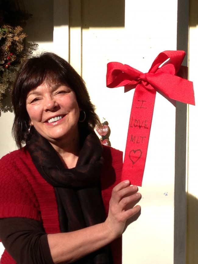 "Melanie Granfors with a 'Yes on MLT"" ribbon."