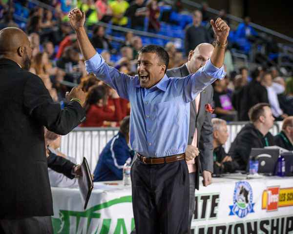 A MTHS head basketball Coach Nalin Sood flashes a rare smile after his team beat University 59-56 in the consolation round of the state tourney Friday. The Hawks will play Seattle Prep at 9 a.m. Saturday for fourth place. (Mark Hopkins photo)