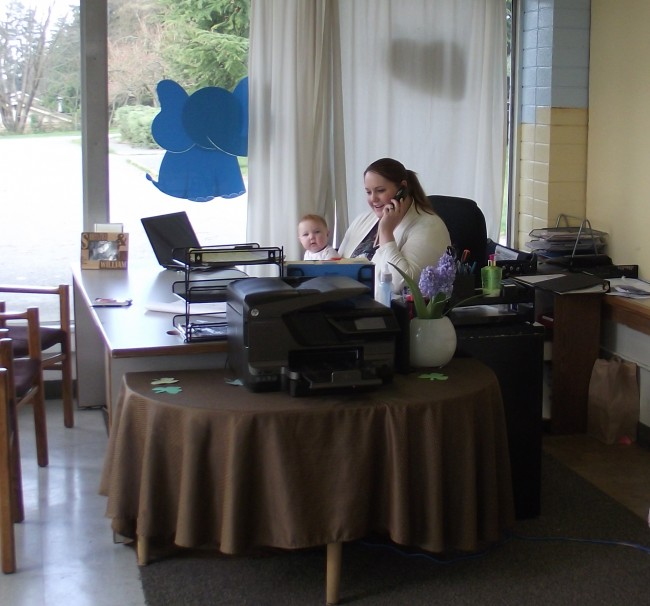 Cornerstone Early Learning Center Director Samantha Sciacca and her six-month-old daughter Lilly in the front office area of the day care.