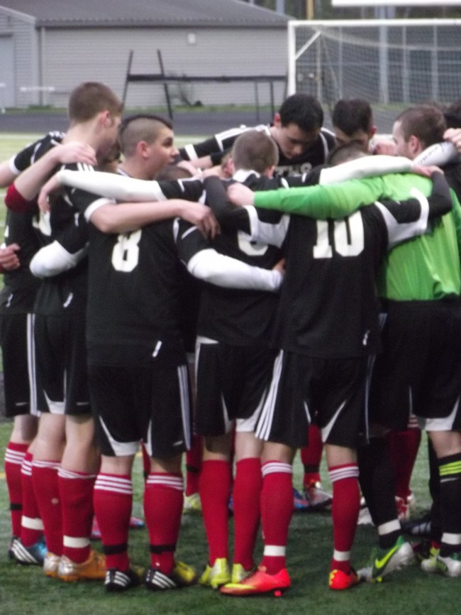 The Terrace soccer team during the pre-game huddle.
