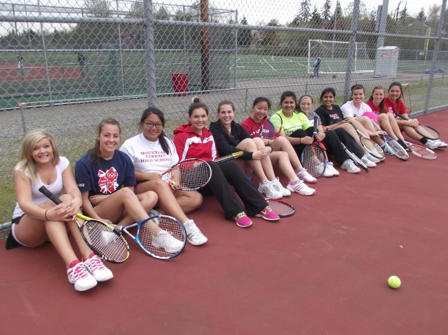The MTHS girls tennis team relaxing after practice last week.
