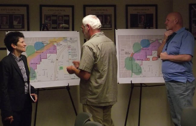 Citizens study maps at Monday's Planning Commission meeting.