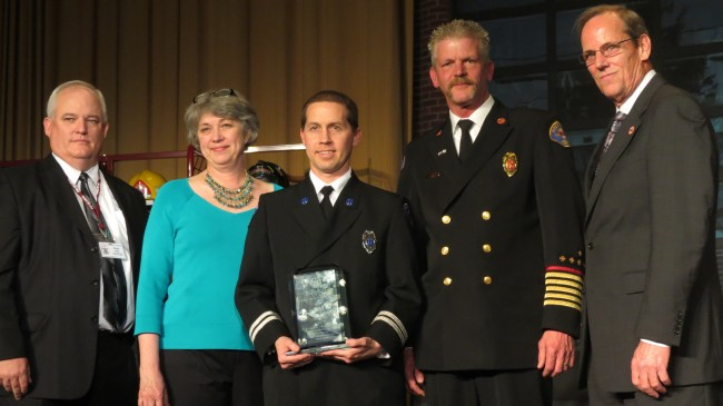 Snohomish County Fire District 1 Commissioner Karen Dingmon, Capt. Shaughn Maxwell and Fire Chief Ed Widdis receive the national Excellence in Fire Service-Based EMS Award presented by Chris Neal (far left), board member of the Congressional Fire Service Institute, and Andrew Wigglesworth (far right), president and chief executive officer of the MedicAlert Foundation, at the National Fire and Emergency Services Dinner in Washington, D.C., on May 9. Fire District 1 was one of only three departments in the country selected for this honor.