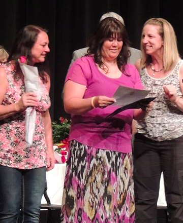 Melissa Reid, center, receives the Golden Acorn Award.