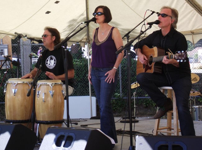"""Those Guys"" entertained early afternoon festival-goers on Saturday. The Seattle band is comprised of (from left to right) Carl Lovgren, Kristi Barnes and John Hribernick"