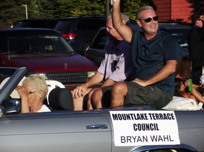 MLT Councilmember Bryan Wahl, in sunglasses, at 2013 Tour de Terrace parade. Former councilmember and state representative Al O'Brien is seated to Wahl's right