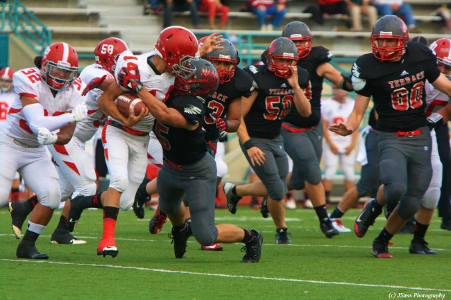 Michael Jensen of the Hawks tackles Stanwood's Collin Hood. (Photo by Joleen Sims)