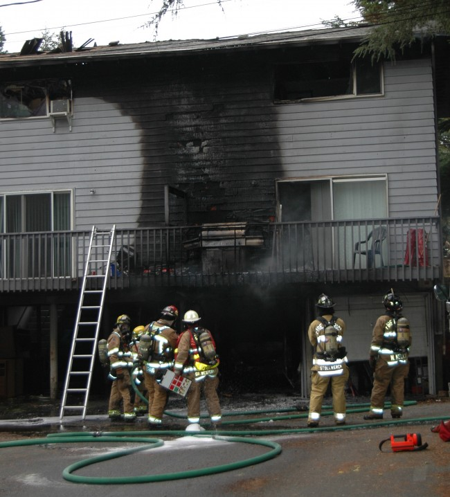 Firefighters at the scene of the Alderwood Manor fire. (Photo courtesy of Fire District 1)