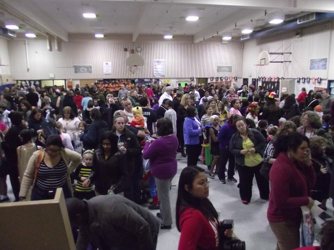 The gymnasium was packed as students and their family members enjoyed carnival games and fun activities led by parents and school staff members.