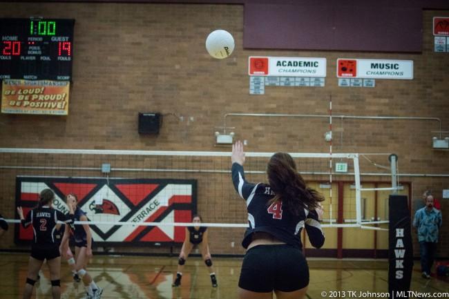 Justine Kelly serves for the Hawks Tuesday night. (Photos by TK Johnson/MTHS Hawkeye)