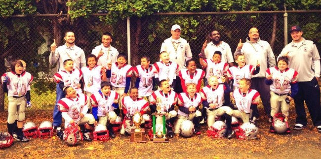 The MTYAA 76ers football team, who finished the season as undefeated champions, pose for a photo.