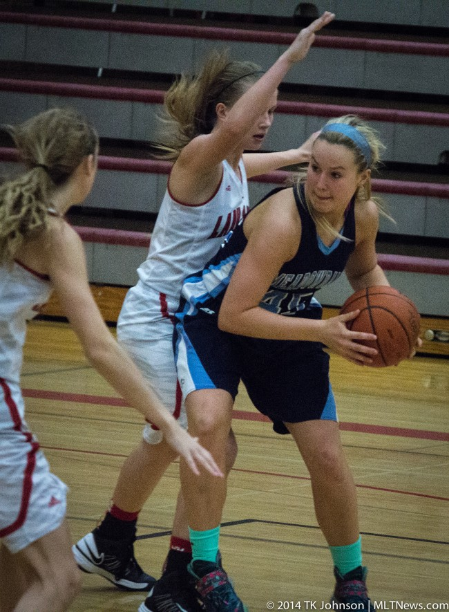 The Mavs' Mackenzie Bretz looks for a way around the Terrace defense.