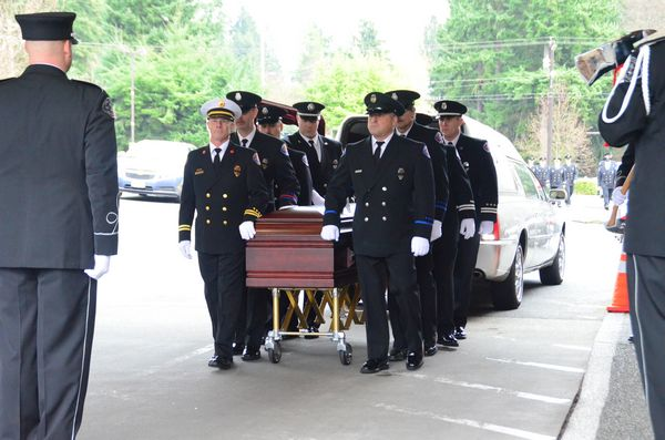 Pallbearers from Fire District 1 carry the casket into the chapel.