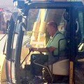 Mayor at the controls as work begins on Cedar Valley Plaza parking lot