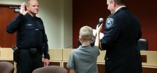 Police Chief administers oath of office to new Police Sergeant, Commander