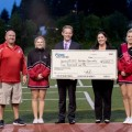 Mountlake Terrace High School football boosters receive $4,000 check from Bill Pierre Ford