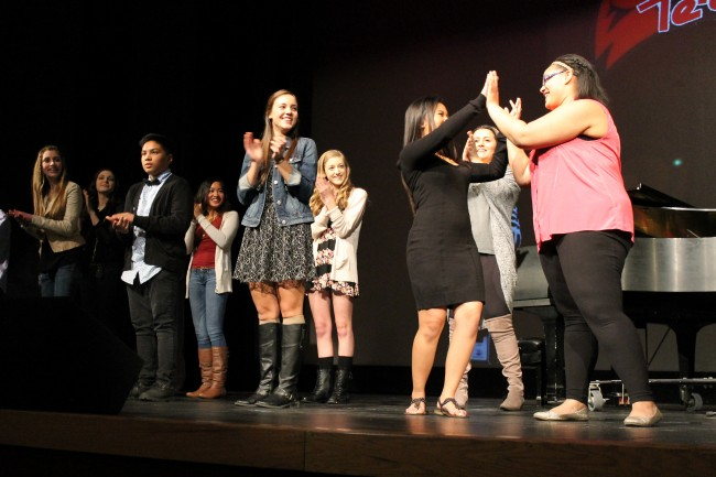 Edmonds-Woodway's Aliya Marulita (in black dress) and Lynnwood's Makeala Eddings (far right) congratulate each other for making the finals of Terrace Idol 2015, set for Feb. 25.