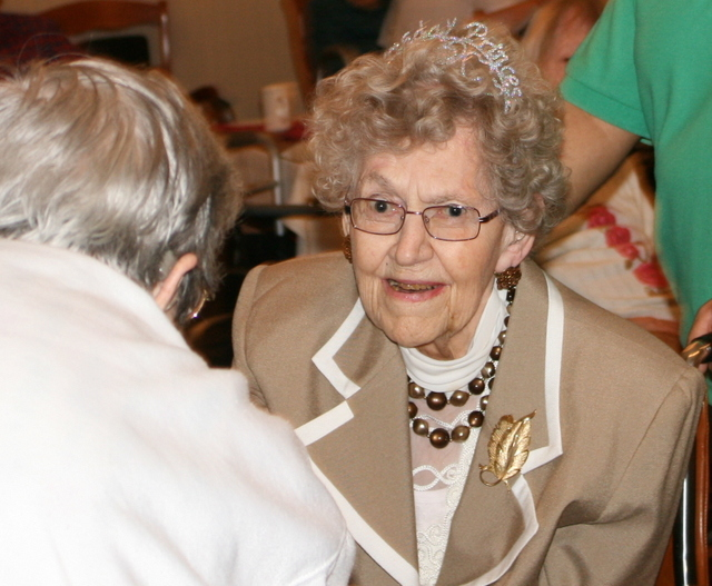 Regina Byrd greets the guests at her 100th year birthday party.