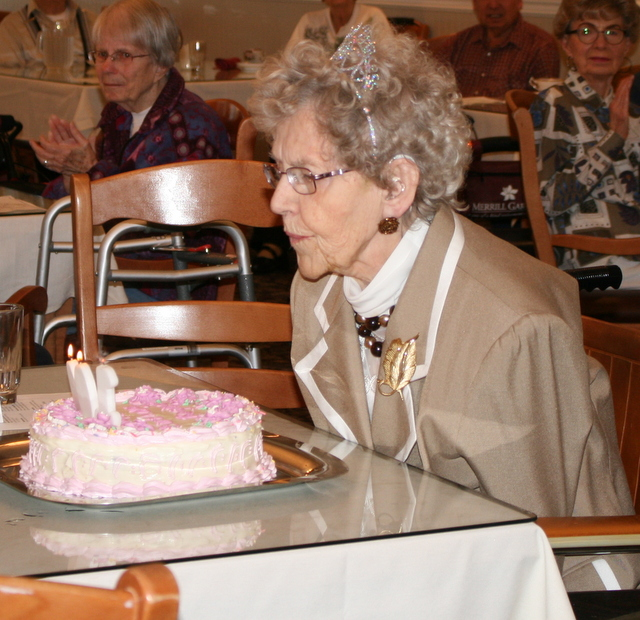 Regina Byrd blows out the candles during her 100th year birthday party Wednesday at Mountlake Terrace Plaza. (Photos by David Pan)