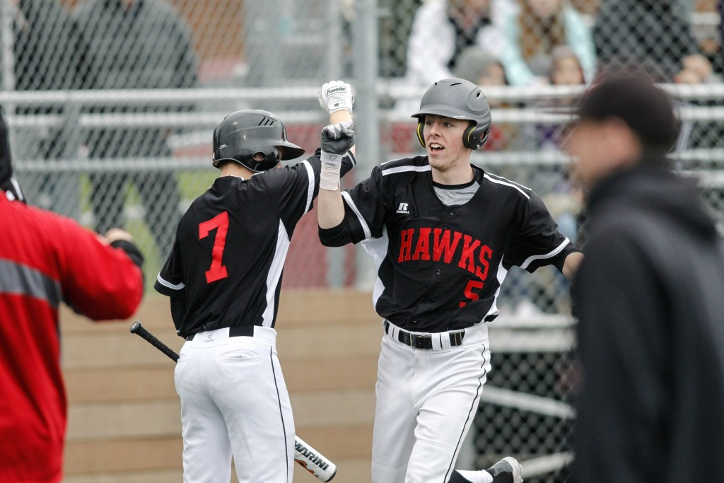 Mountlake Terrace's Drew Serres (right) is greeted at the plate by Jaden Yackley after scoring on a triple and a Kamiak throwing error in the third inning.