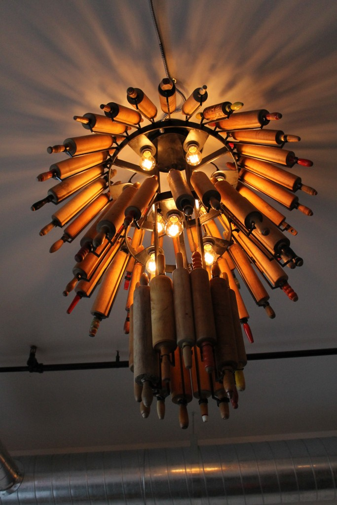 Hanging in the seating area of the eatery is a unique rolling pin chandelier.
