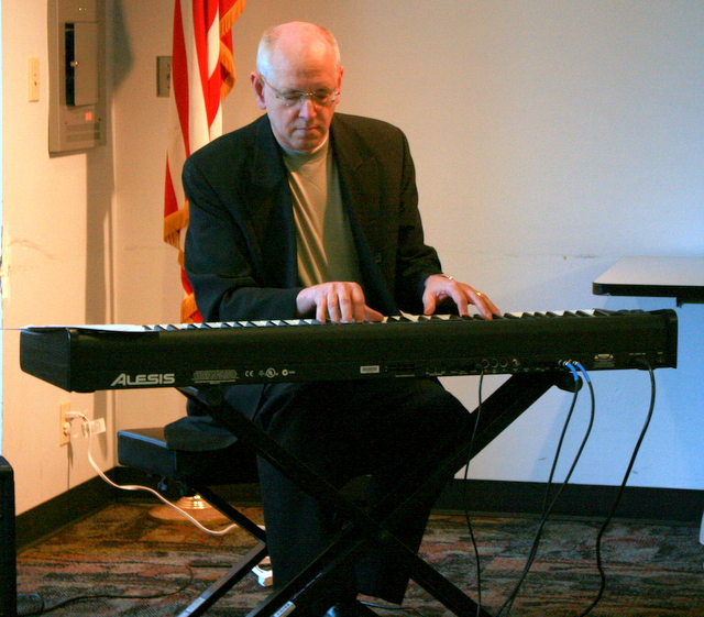 John Burgess provided music during Saturday's Poetry and Live Music Program at the Mountlake Terrace Library. Burgess also played music when Elizabeth Austen read some of her poetry.