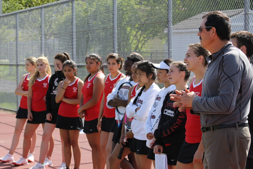 Mountlake Terrace coach Alberto Ramirez (far right) prepares for introductions of his MTHS girls tennis squad prior to their matchup with Lynnwood on Wednesday.