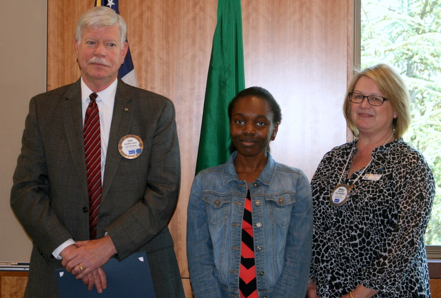 Mountlake Terrace's Vera Okolo (center) receives a $3,000 scholarship from Rotary Club of Lynnwood member Jon Hatch and Lynnwood Mayor Nicola Smith (right) during a luncheon Thursday at Edmonds Community College's Gateway Hall. (Photos by David Pan)