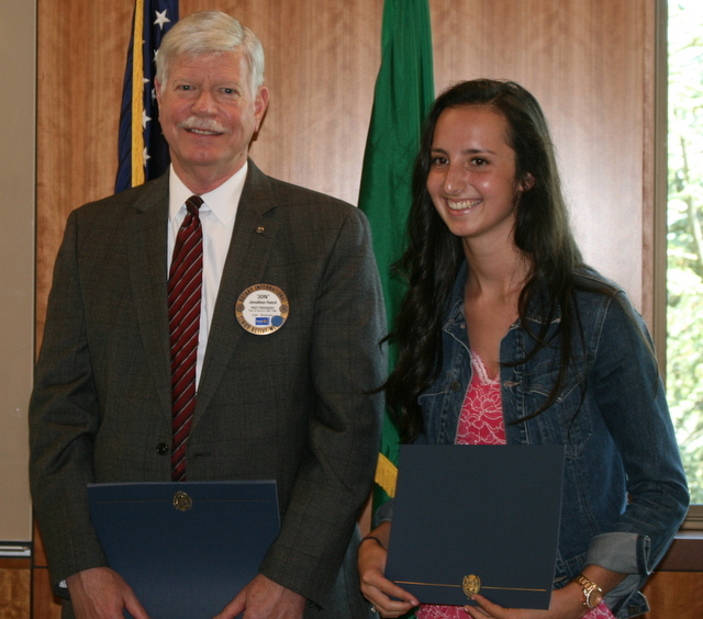 Rotary Club of Lynnwood member Jon Hatch awards Meadowdale's Hannah Long (right) a $4,000 scholarship.