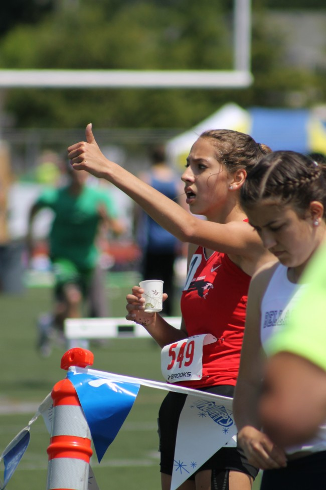 Mountlake Terrace's Jessica Ong signals to her family and friends watching in the grandstands that she qualified for the 800 finals on Saturday.