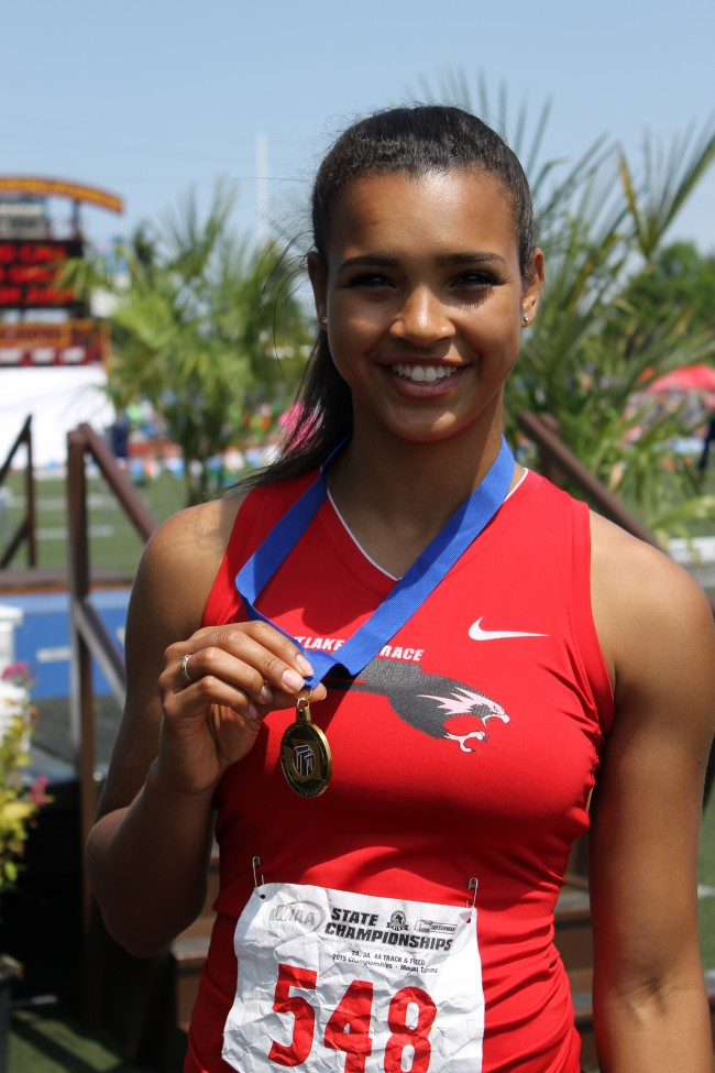 Mountlake Terrace's Chinne Okoronkwo shows off her 3A Girls long jump championship medal won on Friday.