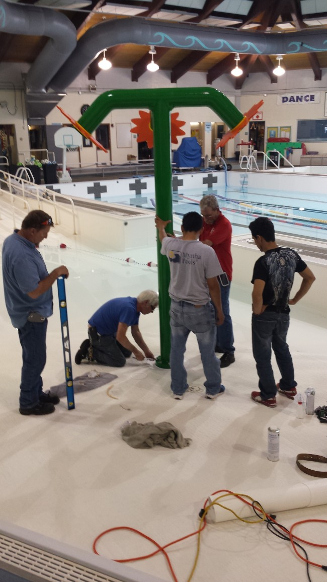 Installation of new spray toy in pavilion pool, June 18