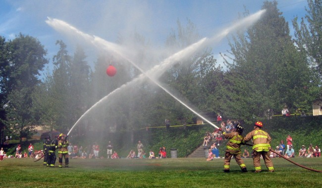 Firefighters square off in last year's Edmonds Fourth of July Waterball Competition.