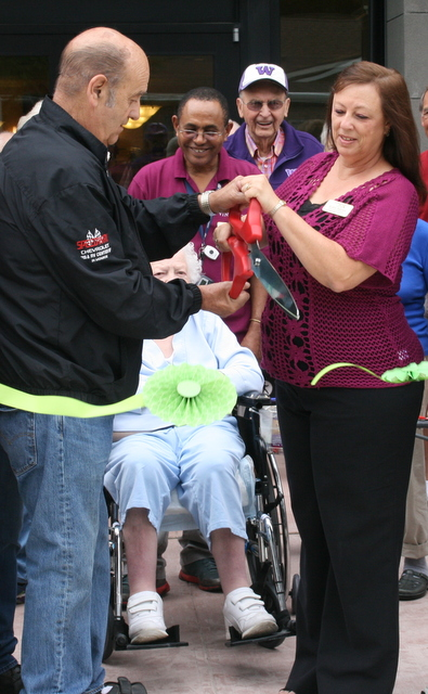 The ribbon is officially cut by Mountlake Terrace Mayor Jerry Smith and Vineyard Park Executive Director Robin Martin (right)