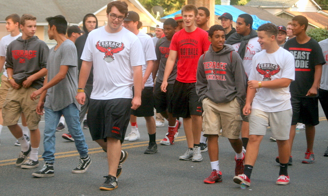 Members of the Hawk football team followed.