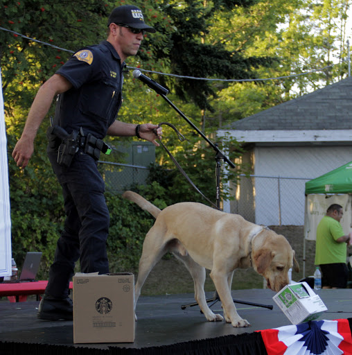 A Police Officer and his dog perform a drug detecting demonstration.