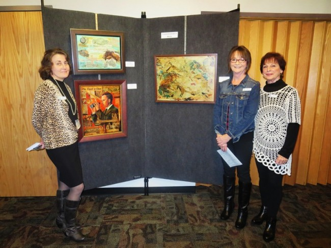 2—Art Commissioners ( L to R ) Lori Knight, Judy Ryan and Marla French pose in front of their work.