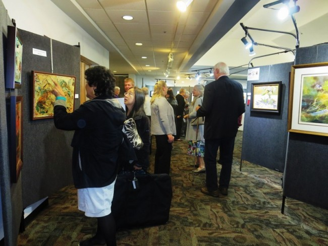 A capacity crowd attended the Artist's Reception.
