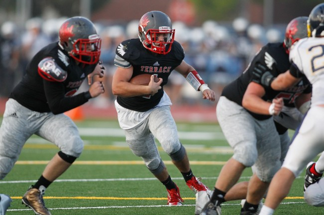 Quarterback Mikey Jenson looks for running room up the middle (photo by Jonah Wallace)