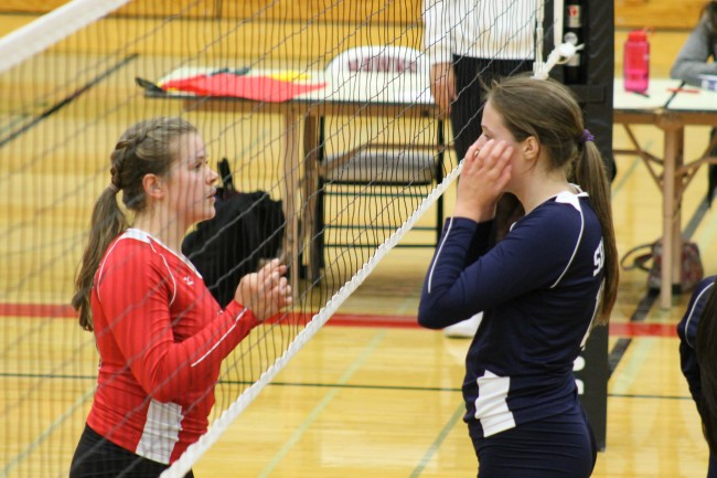 Mountlake Terrace's Leeann Weatherby (left) and Everett's Sophie Stavig stare each other down through the net during the Hawk-Seagull volleyball clash.